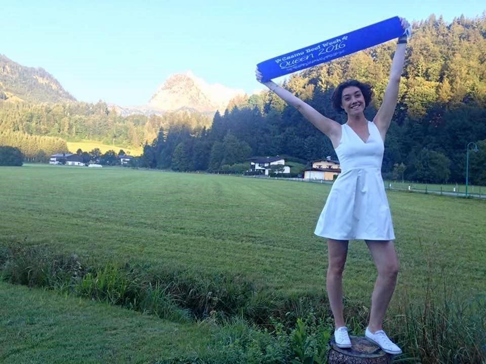 2016's Beef Week Queen showing her victory sash in the Swiss Alps.