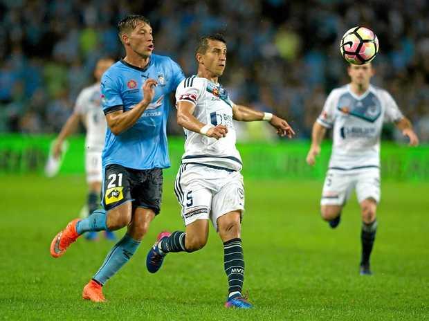 Filip Holosko (left) of Sydney FC competes with Daniel Georgievski of Melbourne Victory at Allianz Stadium.