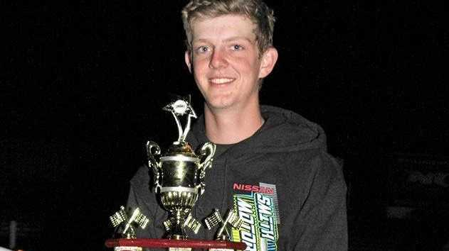 CHAMPION: Toowoomba speedway driver Matty Smith with his National Modified Sedans Title trophy won at Murray Bridge Speedway, South Australia.