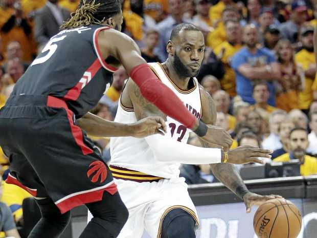 Cleveland's LeBron James drives past Toronto's DeMarre Carroll.