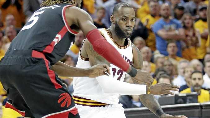 Cleveland's LeBron James drives past Toronto's DeMarre Carroll.