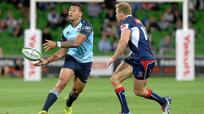 Israel Folau of the Waratahs is chased by Reece Hodge of the Rebels.