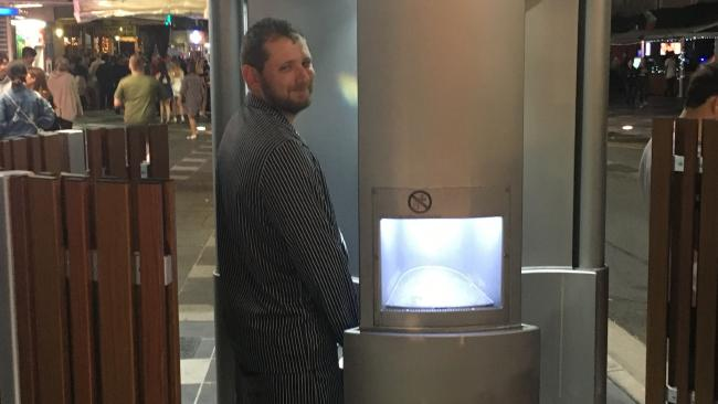 "Thomas Bartley, 27, visiting Surfers Paradise for a buck's weekend, tests out the new pop-up urinal on Orchid Avenue on Saturday night: ""It probably could have a bit more screening."""