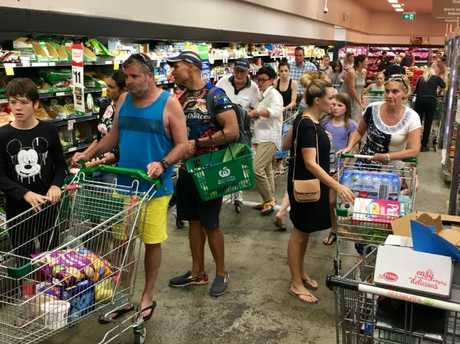 Not browsing, lining up... the queue stretches up and down aisles at Woolworths DFO Brisbane yesterday.