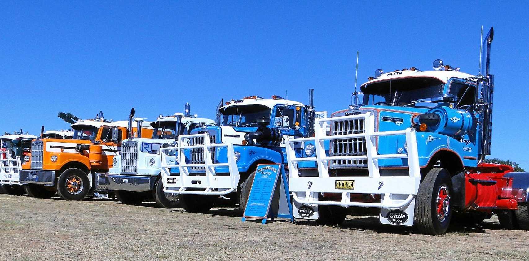 The White trucks line up.