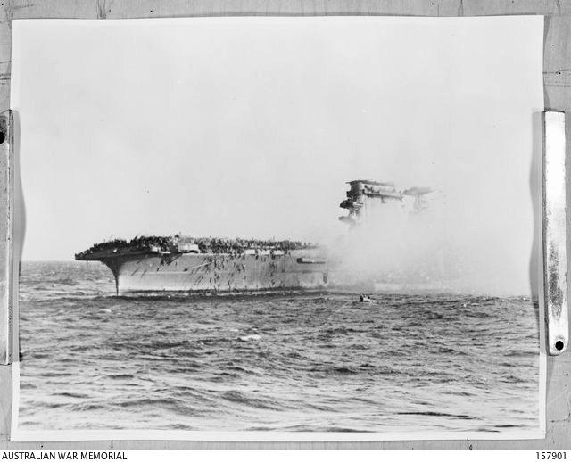 CORAL SEA BATTLE, 1942-05-07-08. THE UNITED STATES NAVY AIRCRAFT CARRIER LEXINGTON ON FIRE. MANY OF THE CREW CAN BE SEEN ABANDONING SHIP.