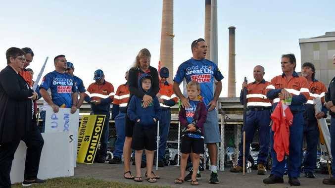 Australian Manufacturers' Workers Union delegate Andrew Lockwood with his family at an early morning protest outside Gladstone Power Station.