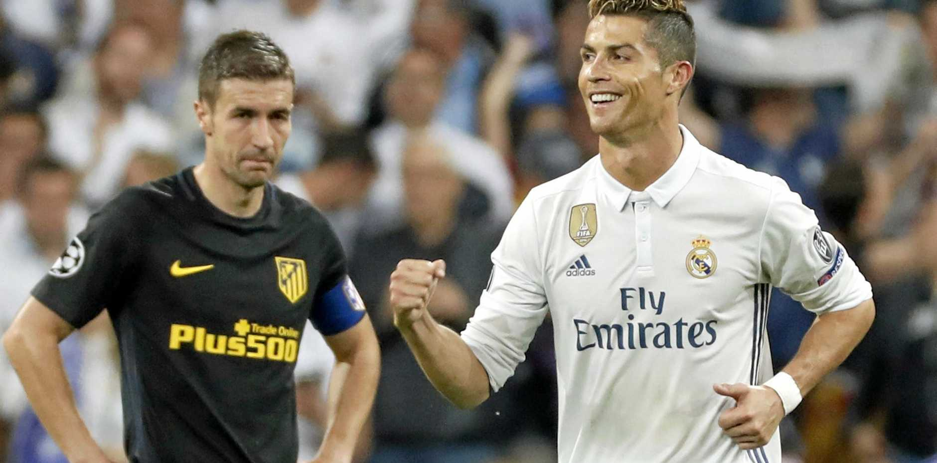 Real Madrid's Portuguese striker Cristiano Ronaldo (right) celebrates scoring the 3-0 during the UEFA Champions League semi-final match between Real Madrid and Atletico Madrid.