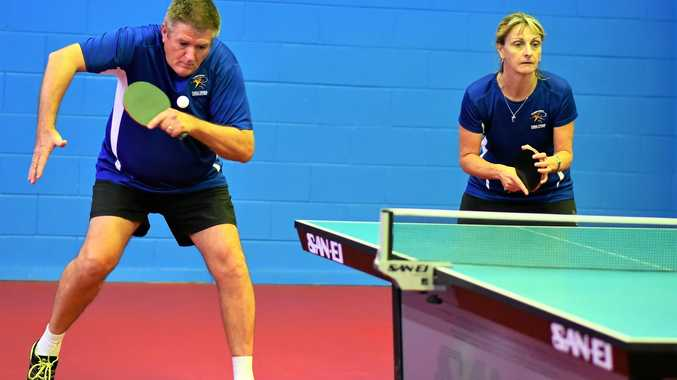 TABLE SERVICE: Toowoomba's Steve and Bernadette Mitchell in action in table tennis.