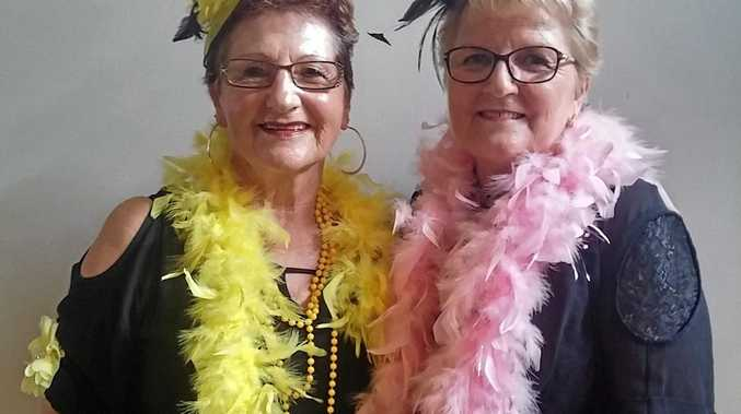 DOUBLE ACT: Margaret Harris (left) and Margaret Bye dress the part for their performance in the Gympie Country Music Club's recent concert.