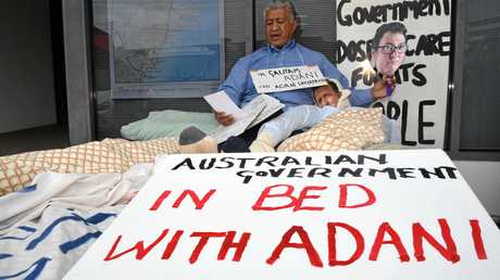 Protester Tu'ulenana Iuli in bed with an effigy of Luke Hartsuyker at a protest against the Adani Carmichael coal mine in Queensland's Galilee Basin. Coffs Harbour, May 3, 2017.