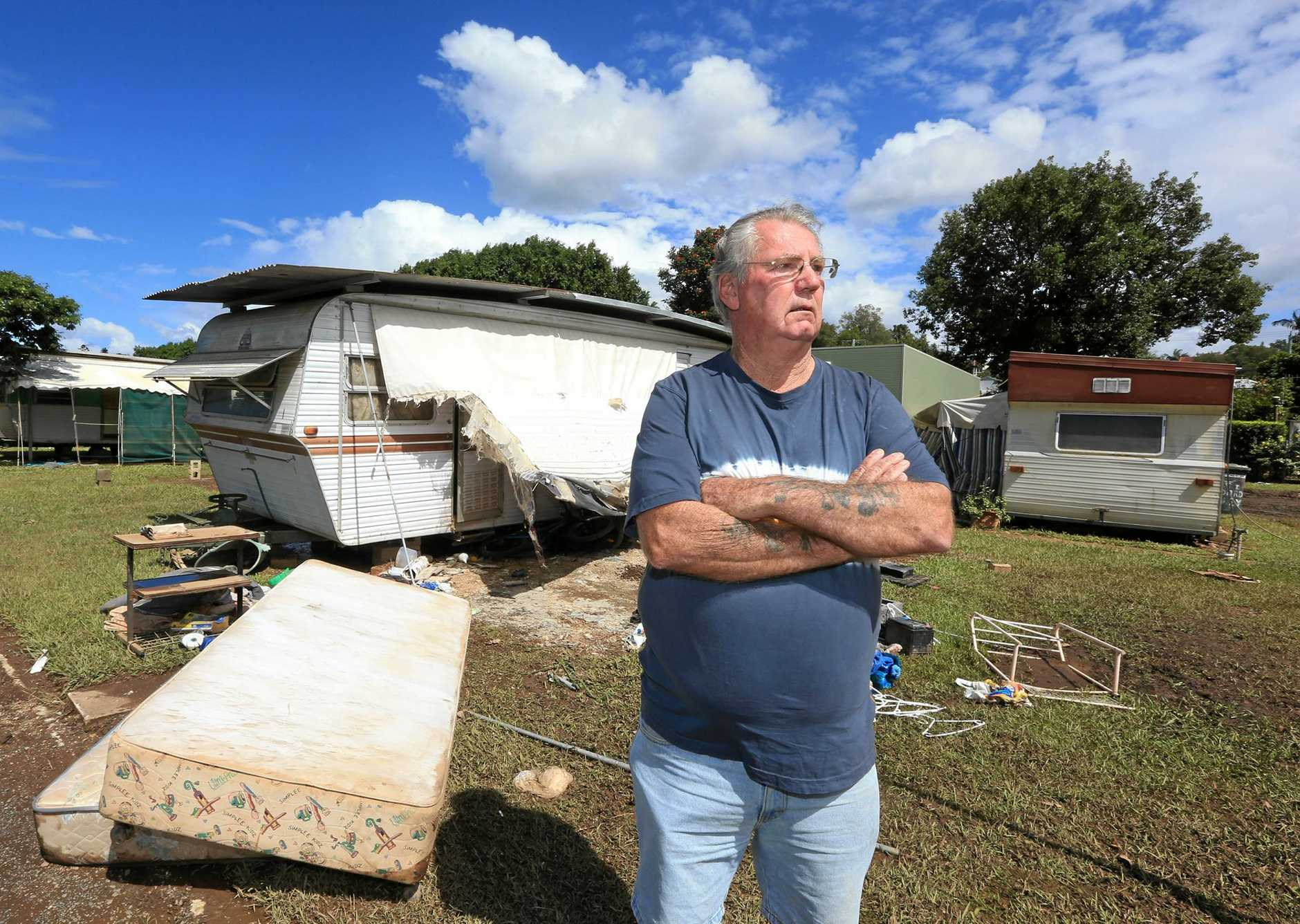 Graeme Bolton from the South Murwillumbah Caravan park with one of the destroyed caravans when the area flood after the Tweed River broke its banks last Thusday.