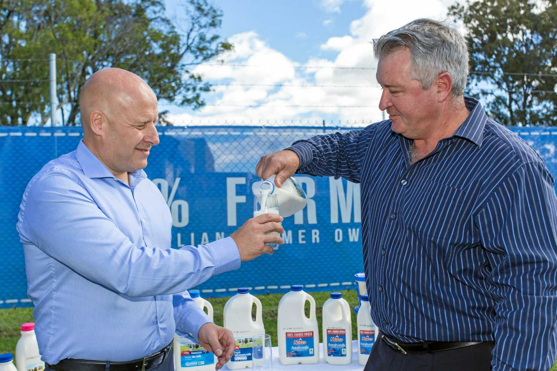 Coles State General Manager Jerry Farrell with Norco CEO CEO Brett Kelly.