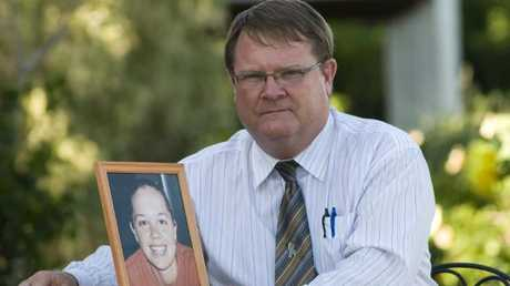 Shane Urquhart with photo of his daughter Sally who died in the 2005 crash.
