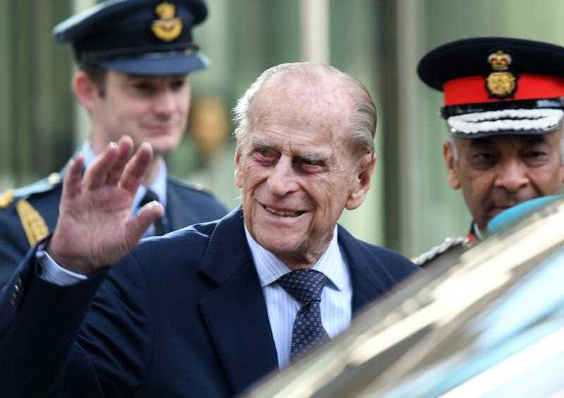 Britain's Prince Philip, the Duke of Edinburgh waves to well-wishers after he and Britain's Queen Elizabeth II (unseen) officially opened the new Cyber Crime Security centre in London, Britain, 14 February 2017.