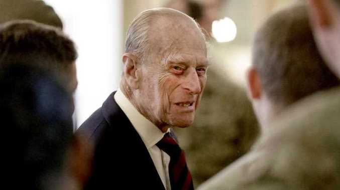 Britain's Prince Philip, in his capacity of Colonel, Grenadier Guards, chats to Sergeants from 1st Battalion Grenadier Guards in their Mess at Lille Barracks in Aldershot, England, Thursday, March 30, 2017.