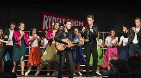 Eliot Argus with the guitar in front of the cast as Toowoomba State High School puts on Grease The Musical, Thursday, May 4, 2017.