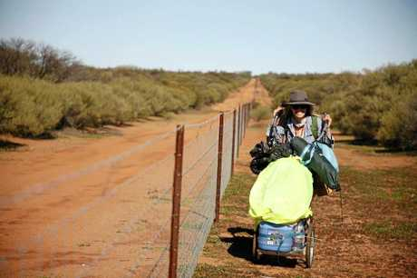 Lindsey walks the rabbit-proof fence.