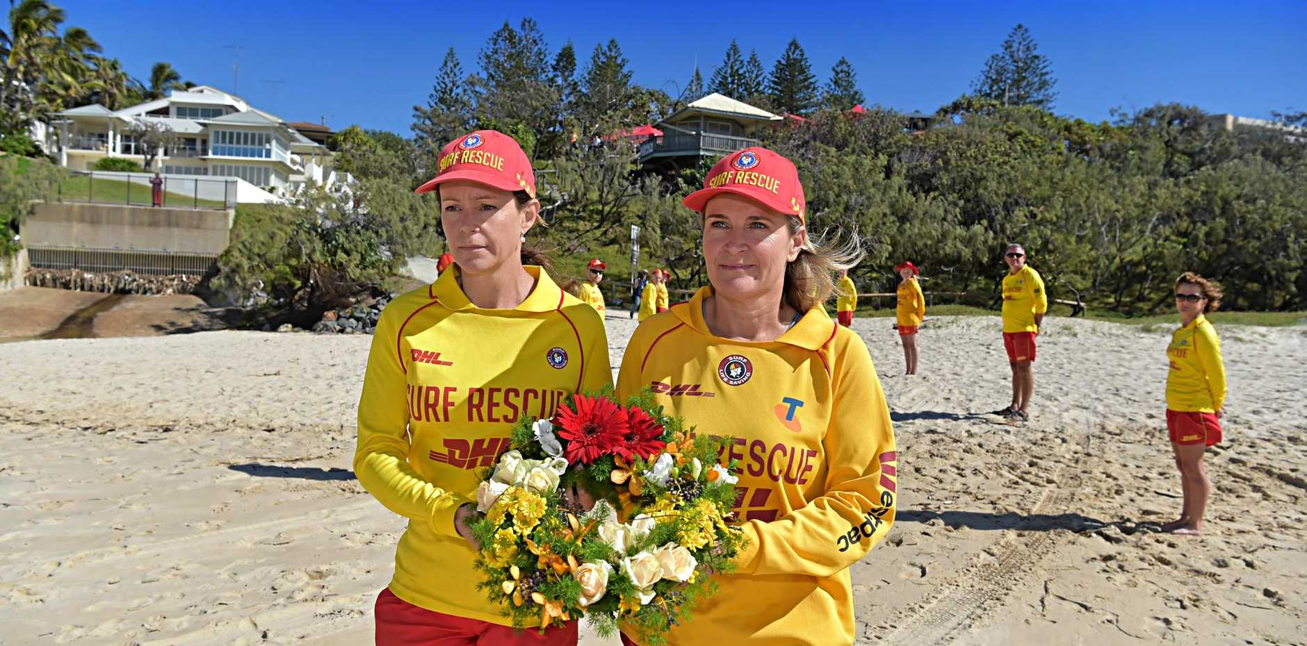 SOLEMN: Surf Life Saving Queensland hold a Memorial Day service at Sunshine Beach Surf Club.Jane Fraser and Allison Johnstone prepare to take a wreath to the ocean to honour people who have lost their lives.