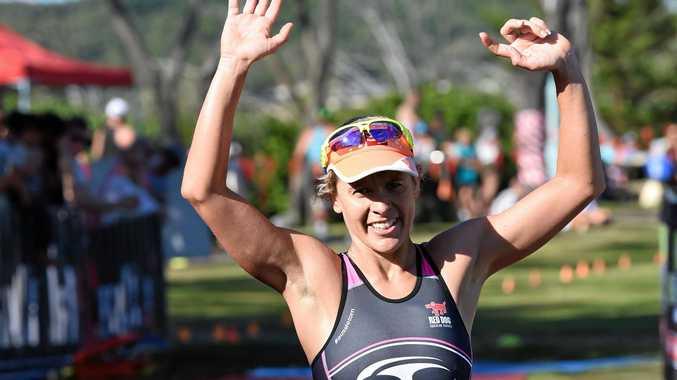 Sarah Crowley wins the Byron Bay Triathlon at Main Beach in Byron Bay.
