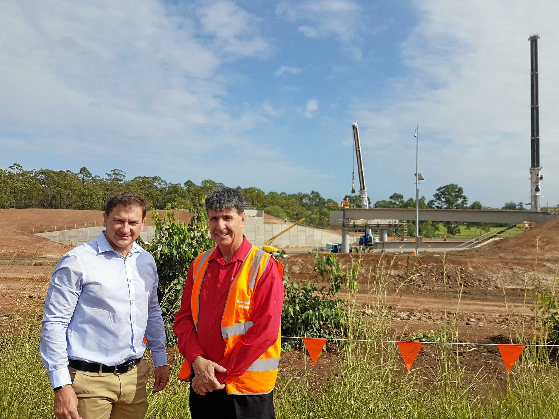 Member for Wide Bay Llew O'Brien and Maryborough MP Bruce Saunders at the Tinana interchange site, where concrete girders were installed in the latest upgrade.
