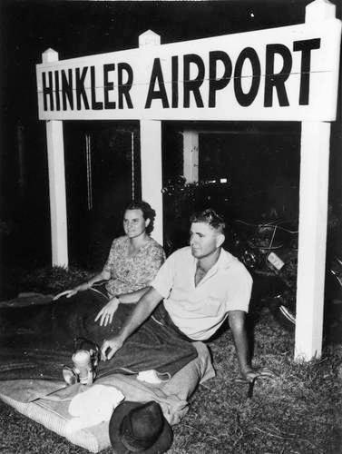 Early spectators awaiting the arrival of Queen Elizabeth II and the Duke of Edinburgh at Hinkler Airport, Bundaberg, 1954.