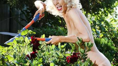 Kelly Anderson enjoys gardening in the buff, especially on World Naked Gardening Day. Picture: Glenn Hampson