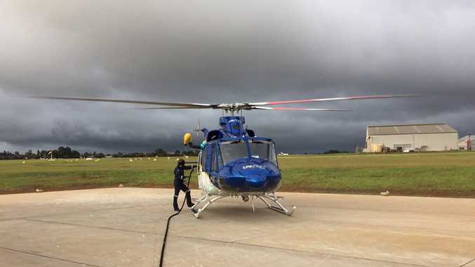 The Toowoomba-based RACQ LifeFlight helicopter airlifted a man from Millmerran after he was crushed by a clump of soil.