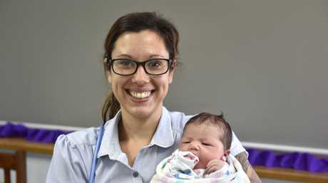 Midwife, Ishah Lamberton nurses the daughter of Leaha Perrin. Toowoomba Hospital midwives celebrate international midwives day. May 5, 2017