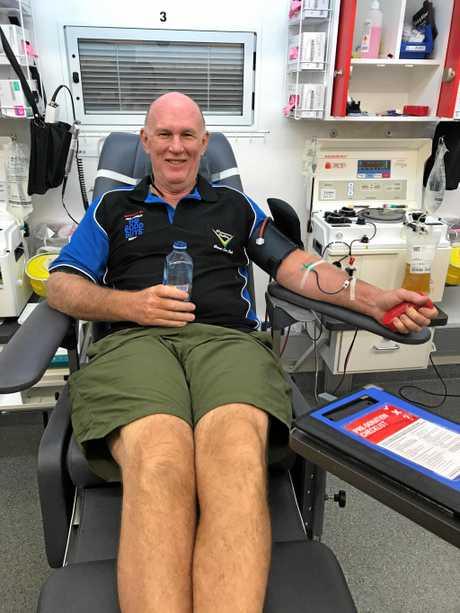 Pioneer Valley Car Club President Ian Trewartha giving blood.