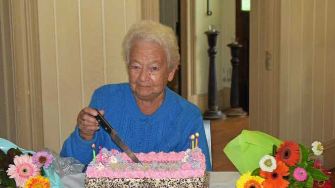 90 YEARS YOUNG: Gympie's Betty Allen cuts her 90th birthday cake.