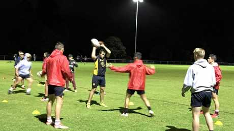 TRAINING DRILL: James Robinson with the ball at Western Mustangs under 18s training at Gold Park ahead of the Mal Meninga Cup grand final.