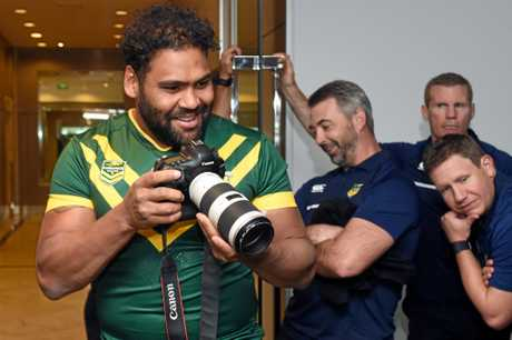 Thaiday has some fun with photographers during a Kangaroos media session.