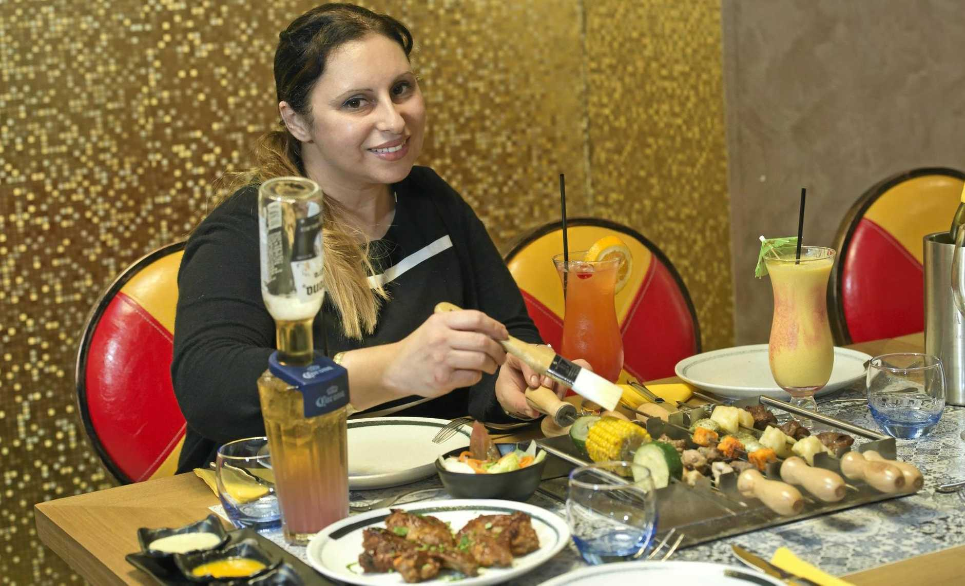 DO IT YOURSELF: Absolute Grill co-owner Nadia Madan demonstrates the concept of over-the-table live grill barbecuing.