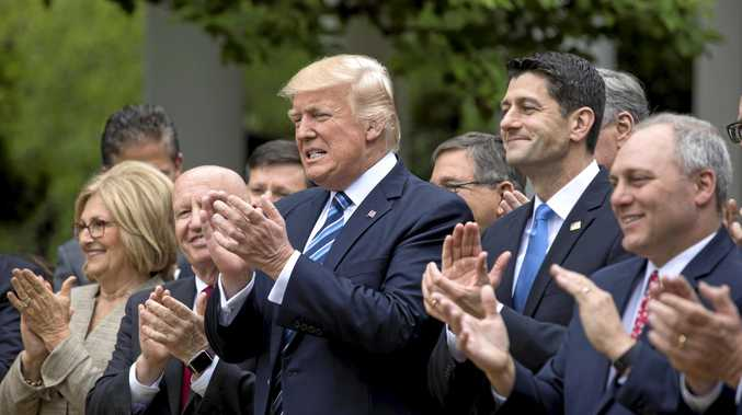 US President Donald Trump and other lawmakers prepare to speak after the House voted to repeal and replace Obamacare with a Republican version of the healthcare law.