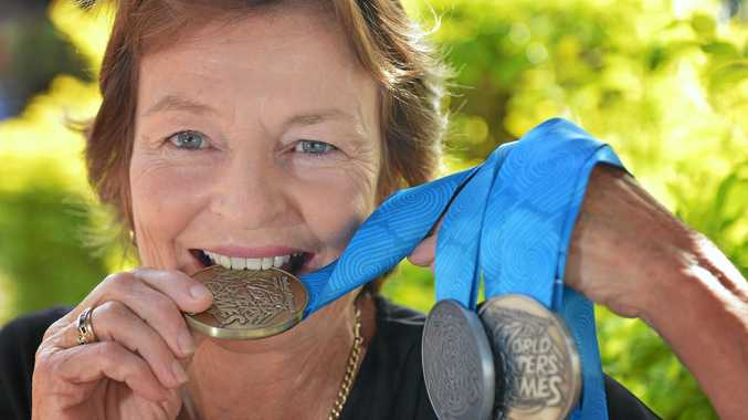 GOLDEN GIRL: Kate Carmichael with the medals she won at the world titles.