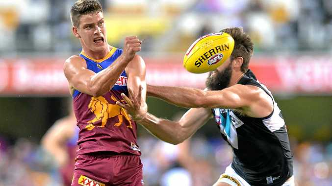 NEW DEAL: Brisbane Lions Jarrod Berry gets a handball away. The Lions are expected to extend his current deal by two years his impressive start to the year.