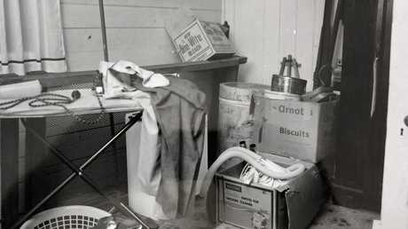 The cluttered ironing room in the McCulkin house.