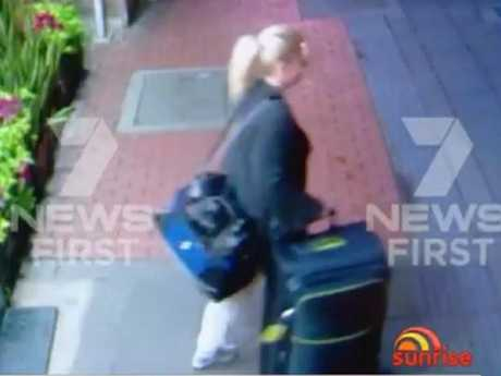 Ms Sainsbury leaving the $40 a night downtown hotel shortly before her arrest.
