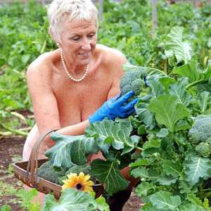Nude wife out gardening