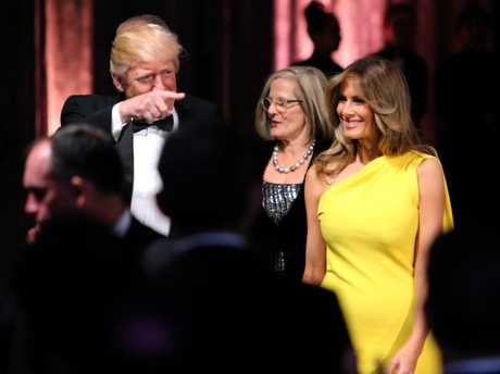 US President Donald Trump and his wife Melania followed by Lucy Turnbull on the USS Intrepid.