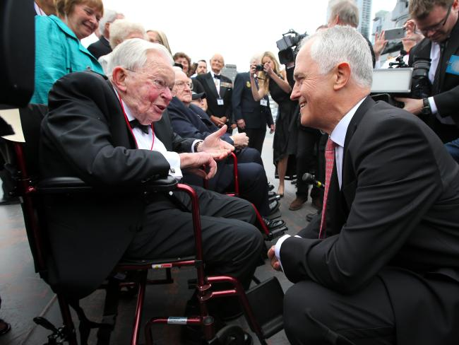 Prime Minister Malcolm Turnbull speaks with veteran Gordon Johnson, who survived the Battle of the Coral Sea at the 75th anniversary dinner on the USS Intrepid in New York City.