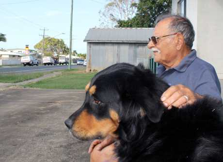 Cono Lisciandro, who lives several doors up from the scene of a suspicious death at a house on Bedford Road, Mackay, says his dog Cafattu joined a chorus of other barking dogs early on Sunday morning, around the time police found a man's body.