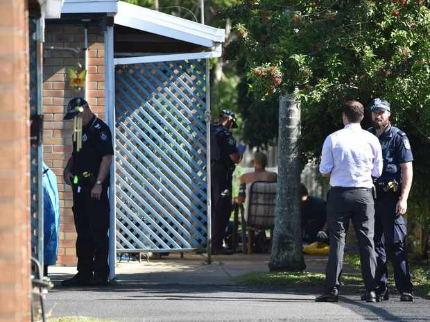 Police at the scene of an alleged stabbing of a man in his forties at a unit on George St, Pialba.