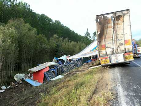 WIPED OUT: The truck which rolled over on the Bruce Hwy this morning, causing traffic chaos.