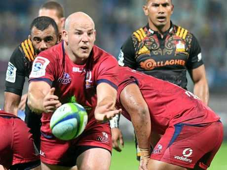 Stephen Mooret ries to get the Reds moving forward. Source: AAP