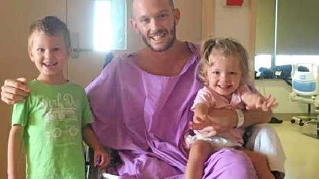 Long road to recovery: Glenn with his son and daughter.