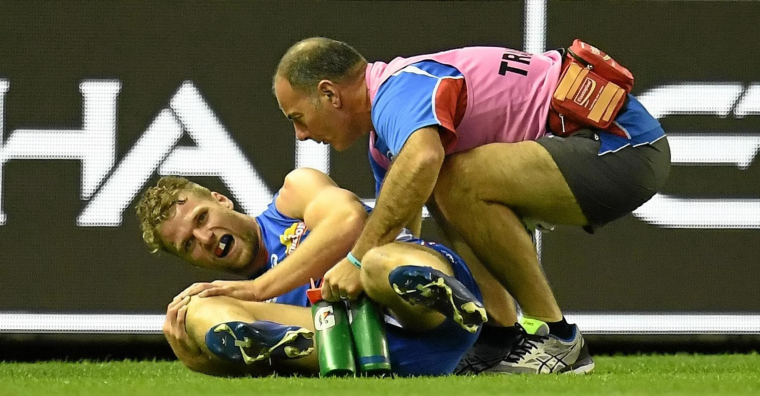 Jake Stringer is treated for his knee injury against Richmond.