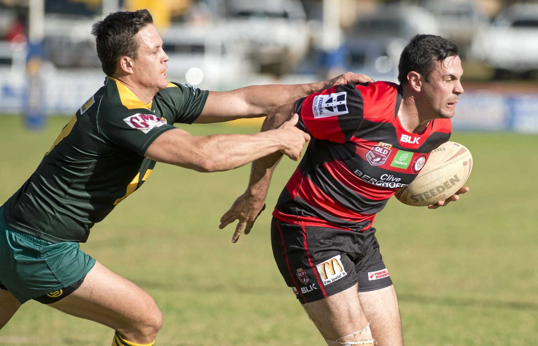 ACTION: Wattles defender Matthew McCarthy tries to tackle Valleys back Liam Capewell at Herb Steinohrt Oval.