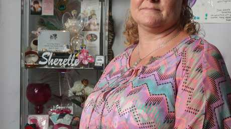 Marlene Locke, above with her shrine to her murdered daughter Sherelle, is forever haunted by watching the girl die.
